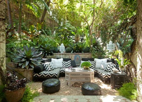 Tropical outdoor living space with black and white and moroccan ...