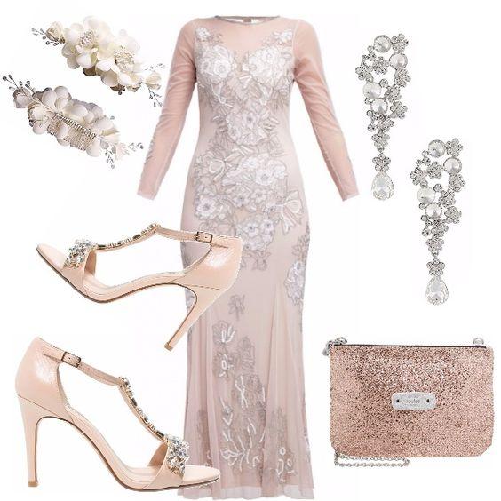 Un outfit da sogno! Abito lungo rosa soft impreziosito da pizzi e ricami. Sandalo in pelle nude tacco a stiletto con motivo di pietre dure e cristalli. Pochette laminata rosa polvere, orecchini con brillantini e perle. Pettinini con fiori per l'acconciatura.