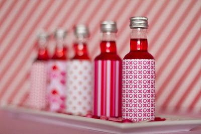 Cover bottles with scrapbook paper to fit theme of party