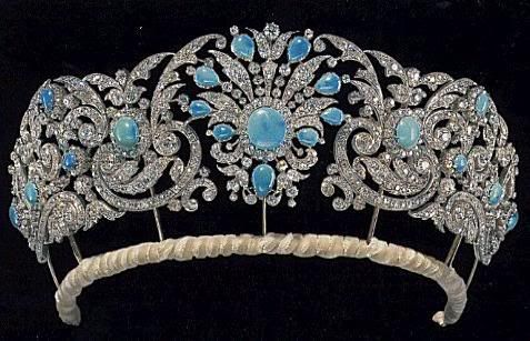 In 1893, HSH Princess Mary of Teck married the HRH Prince George, The Duke of York (future King George V) and received from her parents, The Duke and Duchess of Teck, a parure of three turquoise brooches, a tiara, necklace, and earrings.