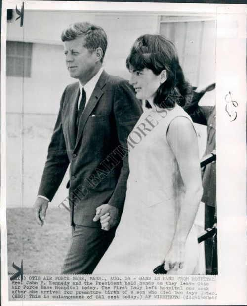 August 14th, 1963 - The Kennedys hold hands as they leave the hospital after the premature birth & loss of their son Patrick.