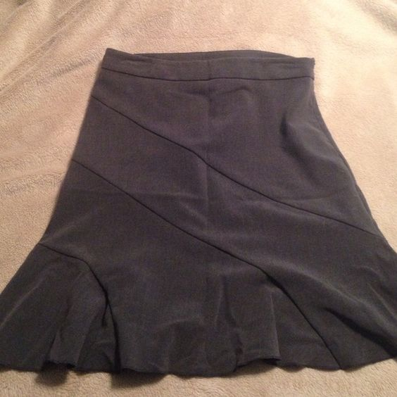 Grey Pencil Skirt with ruffled bottom Grey Pencil Skirt with ruffled bottom detail. 5% spandex- material has some stretch. Some minor pulling near the zipper as pictured. Skirts Pencil