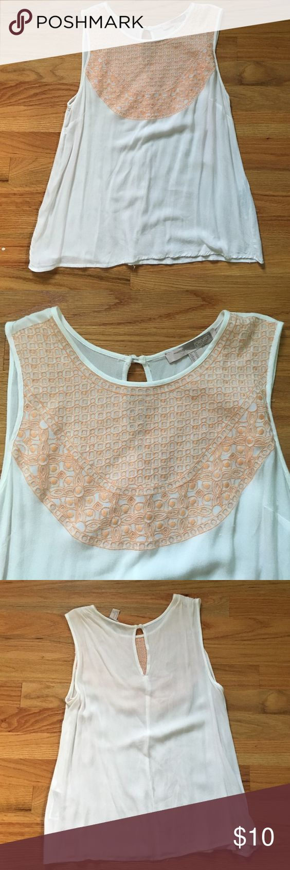 Forever 21 | Sleeveless Top Forever 21 Sleeveless Top! White top with orange detail/embroidering in front. Back of shirt has a button at the top. Very good condition and goes great with jeans! 100% Rayon. Forever 21 Tops Tank Tops
