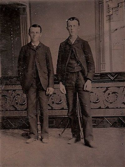 Victorian-death-photos. Both of these men are dead and set up on a stand