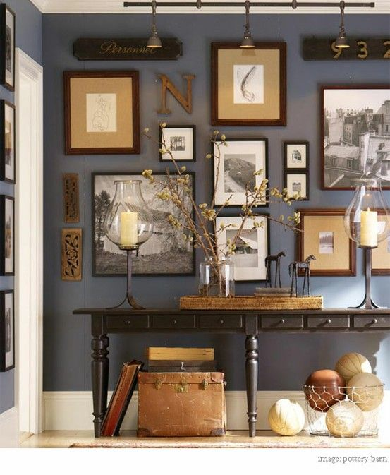 love this wall, the colors, the layout, the contents, all good. Grey wall and gold and black frames: