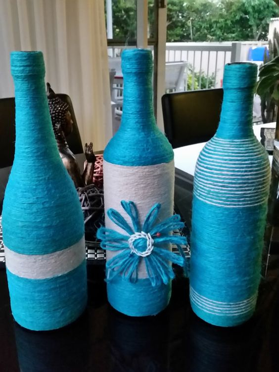 MIX AND MATCH BLUE AND YELLOW TWINE WRAPPED WINE BOTTLES - $8.00 EACH BOTTLE WORKS WELL IN SETS OF 3 OR MORE CHOOSE YOUR THEME - ALL YELLOW OR ALL BLUE OR COMBINATION OF BOTH EXTRA LOOSE FLOWERS IN EACH COLOUR ALSO INCLUDED BUT NOT SHOWN IN PHOTOS LOVELY ADDITION TO YOUR HOME FOR HIGHLIGHTING COLOUR ALSO MAKES A GREAT GIFT IDEA FOR SOMEONE SPECIAL OR HOUSEWARMING GIFT SHIPMENT COST = $15 PER SET OF 3 OR $17 FOR SET OF 4 SHIPMENT FOR TWO SETS OF 3 WOULD COST $15 X 2