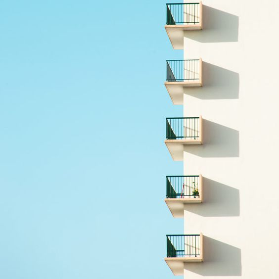"Minimalist urban photography from the series ""Who want sky"". The image shows a detail shot of architecture in front of a blue sky."