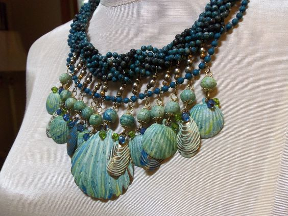 Turquoise Seashells and Braided Bead Necklace. $39.00, via Etsy.