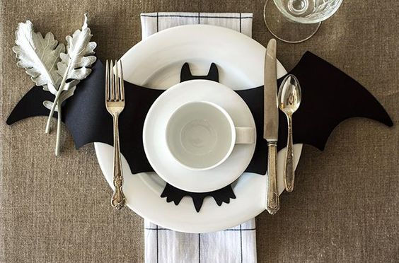 Use black construction paper or chalkboard paper for this Halloween Bat Centerpiece. Idea on Hester and Cook Instagram Page. 31 Inspiring Halloween Mantles and Tablescapes to dress up your home this October Season on Frugal Coupon Living.