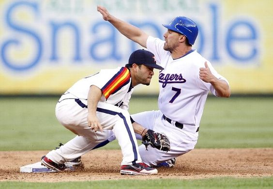ARLINGTON, TX - JUNE 16: David Murphy #7 of the Texas Rangers steals second base beating the tag by Jose Altuve #27 of the Houston Astros at Rangers Ballpark in Arlington on June 16, 2012 in Arlington, Texas. (Photo by Rick Yeatts/Getty Images)  game 66