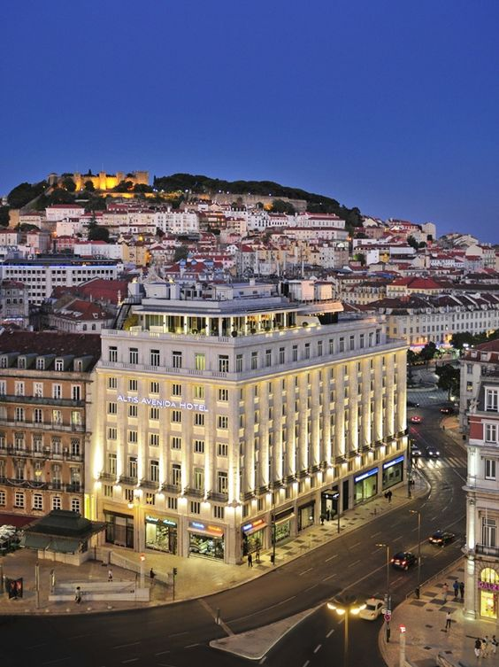 Lisbon: Hotel Mundial and st George #castle on the top of the hill - PORTUGAL: