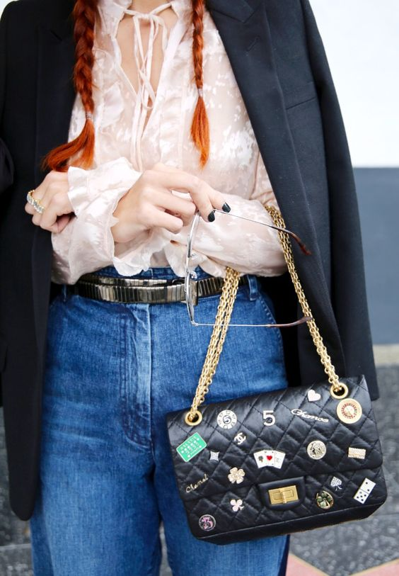 I HATE HER PIGTAILS. There is no hate on the streets of Chanel. I apologize. Her bag is very cool:
