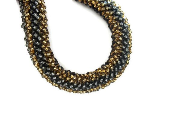 Black Cubic Right Angle Weave Bracelet Embellished with Gray and Gold. $32.00, via Etsy.