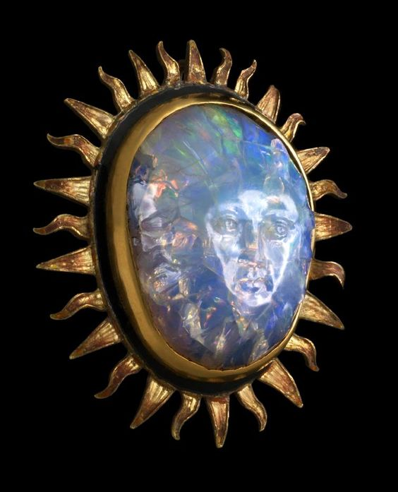 Sun God Opal    The Sun God Opal, carved opal set in gold (35-carat opal) from the mineral collection at Chicago's Field Museum of Natural History as part of the Grainger Hall of Gems Collection.