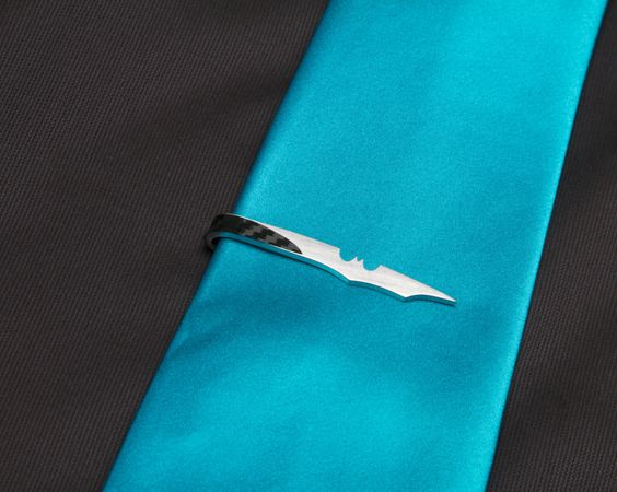 Tie clip with a twist. Christian Bale would never leave the house without it.