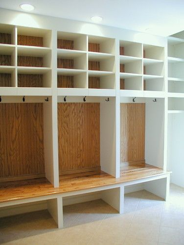 Idea for the boys bathroom.  Doors on top for linnen closet storage.  Individual places for towels and a seat for getting dressed.