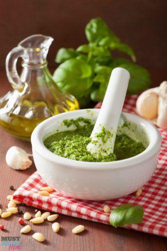 The best basil pesto recipe ever! Easy to make pesto using garden fresh basil, parmesan and garlic! So yummy! Use on pasta, spaghetti squash, bread, pizza and more!