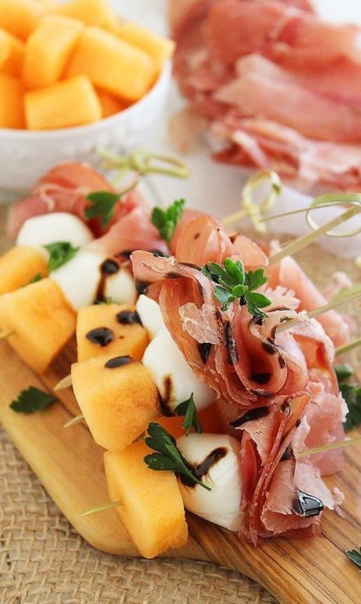 These sweet and salty skewers with prosciutto, melon and creamy mozzarella are easy bites for any spring party! Drizzle with balsamic reduction for a tasty tang.