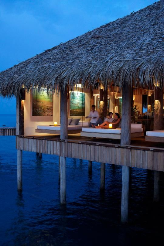 This picture of Song Saa's overwater bar makes us wish we were there.