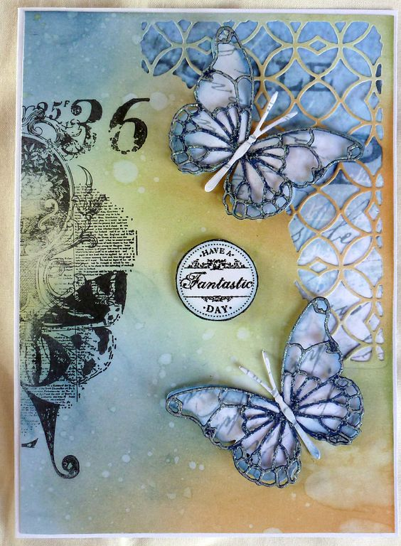 Inked and stamped a Kaisercraft C5882 stamp, (Sorry, can't remember name). The backing paper behind the mixed media die is from Tim Holtz Vintage Shabby paper stash. Darla butterflys to finish: