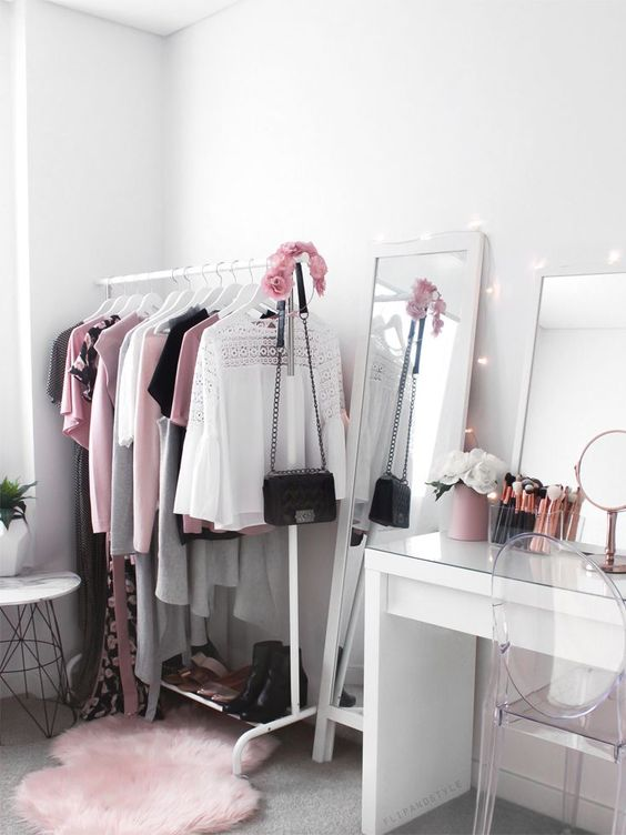 ♡ Wardrobe ♡ Beauty room + makeup vanity with Ikea Malm dressing table and clothing rack. Pink fluffy rug, clear chair, flowers, makeup brushes and plants. Pretty wardrobe, clothing, storage, organisation goals and inspiration.