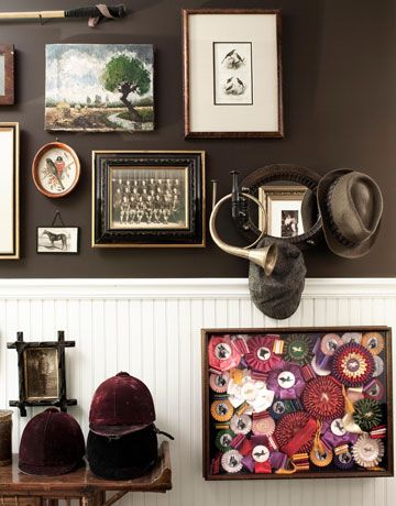 The mudroom highlights equestrian gear — riding hats, a hunting horn, Scheeler's own show ribbons — as well as a photo of Scheeler's grandfather with his high school football team.