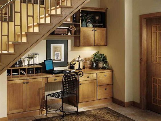 Tuck an office workstation under the stairs.