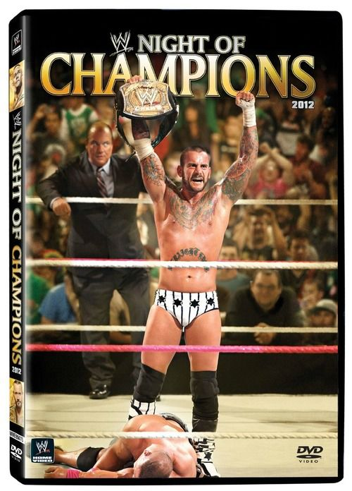CM Punk stands victorious on the cover of the Night of Champions DVD: September 16, 2012  Paul Heyman in the background. John Cena in crumpled defeat. Punk wearing his New York Yankee pinstripe tights. This is a great cover.