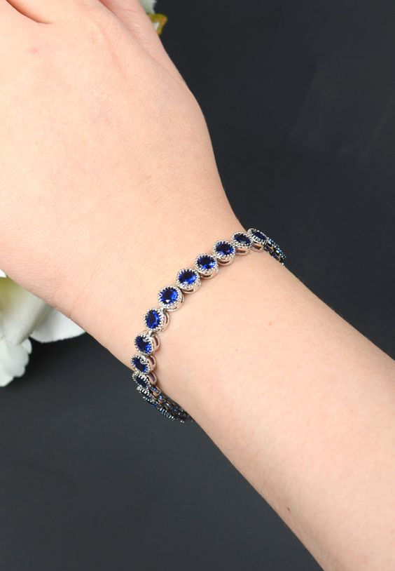 Item details 5 out of 5 stars.      (203) reviews Shipping & Policies navy blue sapphire blue bracelet Wedding Jewelry Bridesmaid Gift Bridesmaid Jewelry Bridal Jewelry bracelet circle bracelet ,bridesmaid gift     ►►► BRACELET  - full strand of crystal , blue sapphire as show  - bracelet is 7 in . If you need different size , please leave me a note on seller box at check out for your size , i will make it for you  -available in silver/white gold , yellow gold , rose gold plated