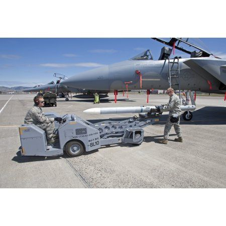 Weapons crew prepare to load an AIM-120 missile on an F-15 Eagle Canvas Art - High-G ProductionsStocktrek Images (35 x 23)