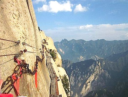 Mt. Huashan China  Hike along the face of Mount Huashan in China, thousands of feet in the air as you walk over wooden 12 inch wide planks tied into the face of the cliffs. This is definitely not a family friendly activity. It doesn't sound that bad, but there are NO hand rails, and the only thing keeping you on the side of the mountain is a safety harness, if you so choose to buy one.