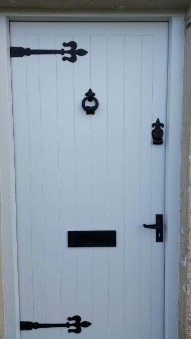 External sheeted door. With wrought iron Ironmongery.