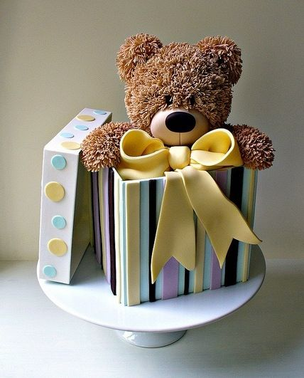 Teddy Bear in a gift box cake by Paul Bradford.  Just love this. It's so perfectly presented and the colours go so well together.  I could just pick that bear up and cuddle it!: