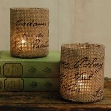 Burlap covered votives. You can also use paint thinner to add whatever saying you want using a laser printer. See my crafts on how to do this