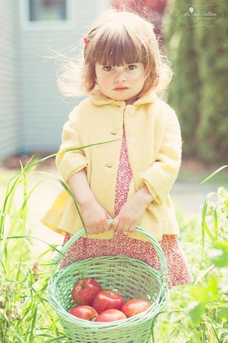 apple basket. little girl. too cute. photography.