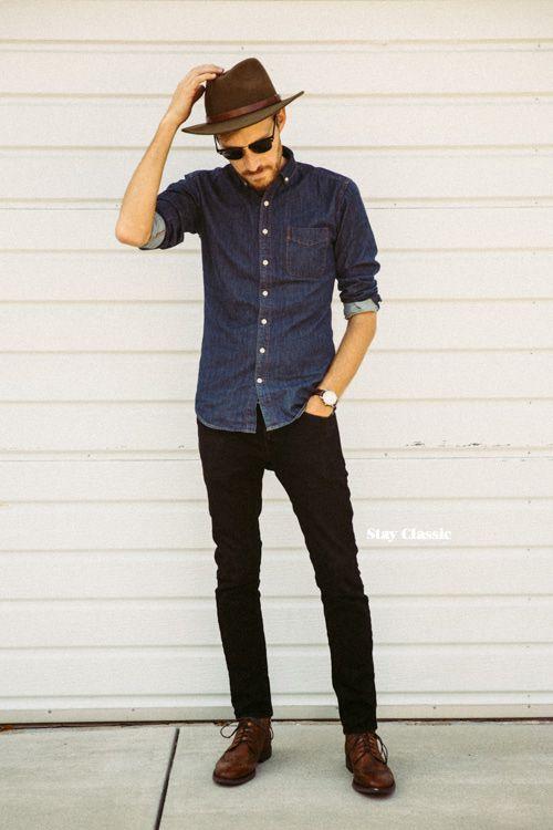 Shop this look on Lookastic:  https://lookastic.com/men/looks/denim-shirt-jeans-derby-shoes-hat-sunglasses-watch/6126  — Brown Wool Hat  — Black Sunglasses  — Black Jeans  — Brown Leather Derby Shoes  — Dark Brown Watch  — Navy Denim Shirt