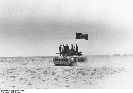 German troops on a captured British Matilda tank earlier in 1942.