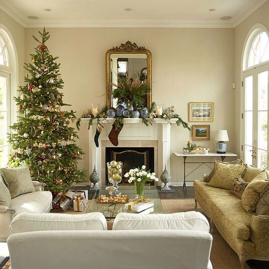 Casual Elegance  For a formal space, keep things simple with low-key Christmas decorations. Here, the stately tree becomes the room's focal point, bearing a graceful assortment of red, gold, and silver ornaments. Sprigs of greenery, gold pinecones, and leaf vines lounge on the mantel, and candle and ornament arrangements add sparkle to the side table and coffee table.: