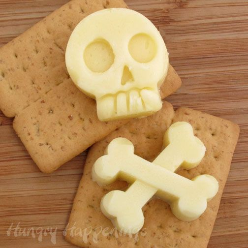 Hungry Happenings: Skull and Crossbones Mozzarella Cheese Shapes for your Halloween party. - How to melt and shape cheese using silicone molds.