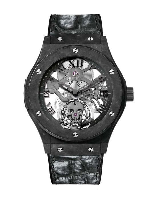Classic Fusion Tourbillon Skull watch from @hublot_watches features a 45mm case made of lightweight ceramic-coated aluminium and, in the quest for lightness, the manual-winding movement has been elaborately skeletonised, shaving off any superfluous parts. #hublots #luxurywatches