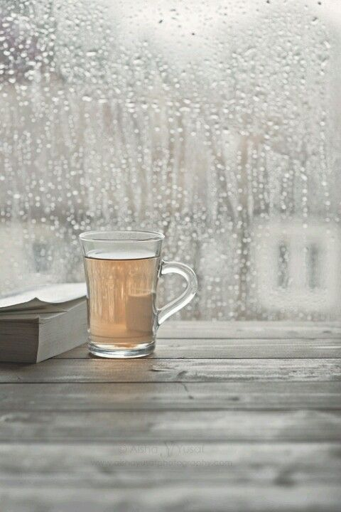 Being inside with something warm to drinks and something nice to read, while the rain keeps drumming on the windows <3