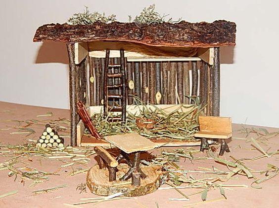 Crèche en bois fabriqué avec des petits rondins et écorces
