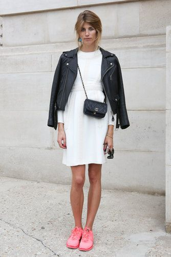 If you ever thought you couldn't wear your Nikes with your day dresses without looking like a shot out of Working Girl, this look will prove you wrong. Her white dress and stylish leather jacket are the perfect foil for fresh athletic kicks.                   Source: IMAXTREE