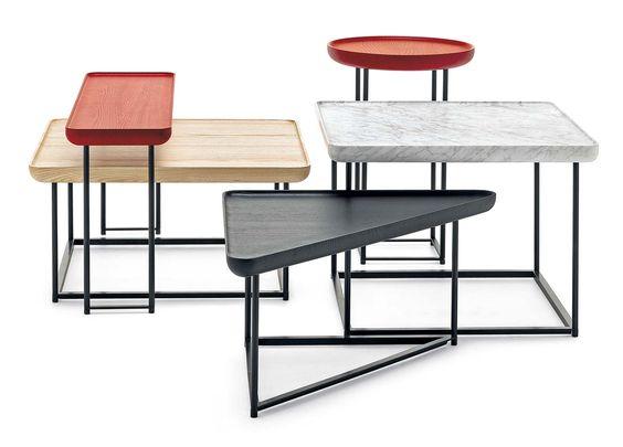 Conçue en 2012, la collection de petites tables graphiques, dessinée par Lucha Nichetto, s'étoffe de nouvelles formes et finitions. Résultat, un puzzle riche et coloré, avec des plateaux en marbre de Carrare, pour les modèles carrés et teintés en rouge pour des modèles ronds et rectangulaires. À combiner à volonté.