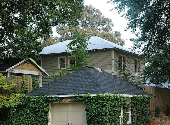 The exterior paint is Nantucket Gray (Benjamin-Moore HC-111). The Trim is Elephant Tusk (OC-8) and Sash is Red River Clay (2091-40).