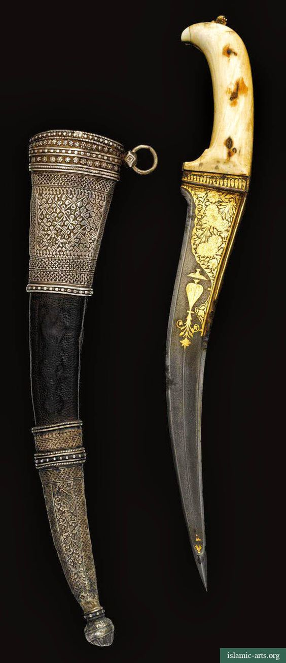 AN IVORY-HILTED DAGGER WITH SILVER-MOUNTED SCABBARD, INDIA