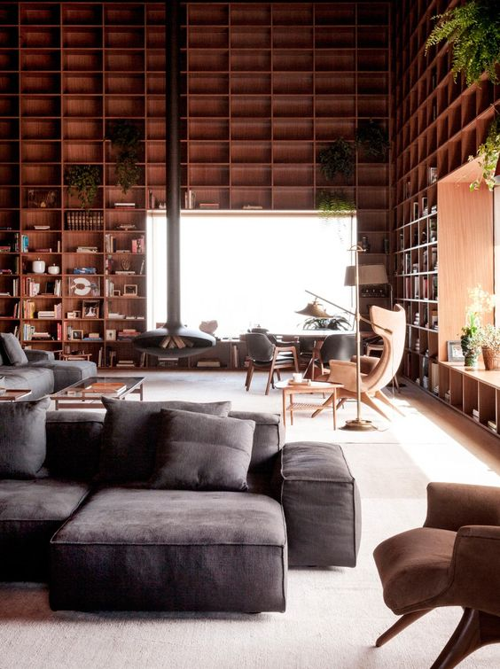 A double height room with floor-to-ceiling wooden shelves | Shelving |  Pinterest | Wooden shelves, Ceiling and Shelves