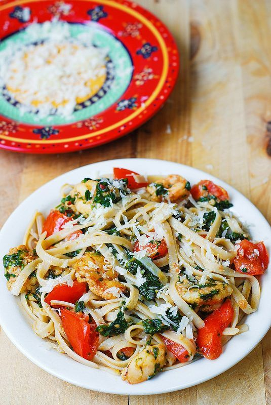 Shrimp, tomato, and spinach pasta in garlic butter sauce. A delicious easy dinner that your family will love!
