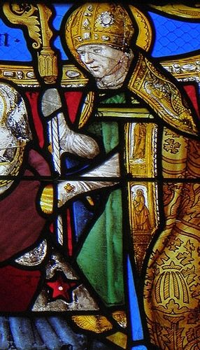 detail of a stained glass window of Saint Lucinus of Angers; date and artist unknown; Church of Saint-Lézin, La Chapelle-Janson, France; photographed on 15 August 2014 by GO69; swiped from Wikimedia Commons; click for source image