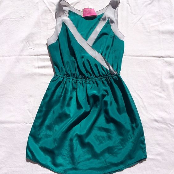 Teal and silver mini dress NWOT. Gorgeous dress, still on the fence about selling! 100% polyester Rory Beca Dresses Mini